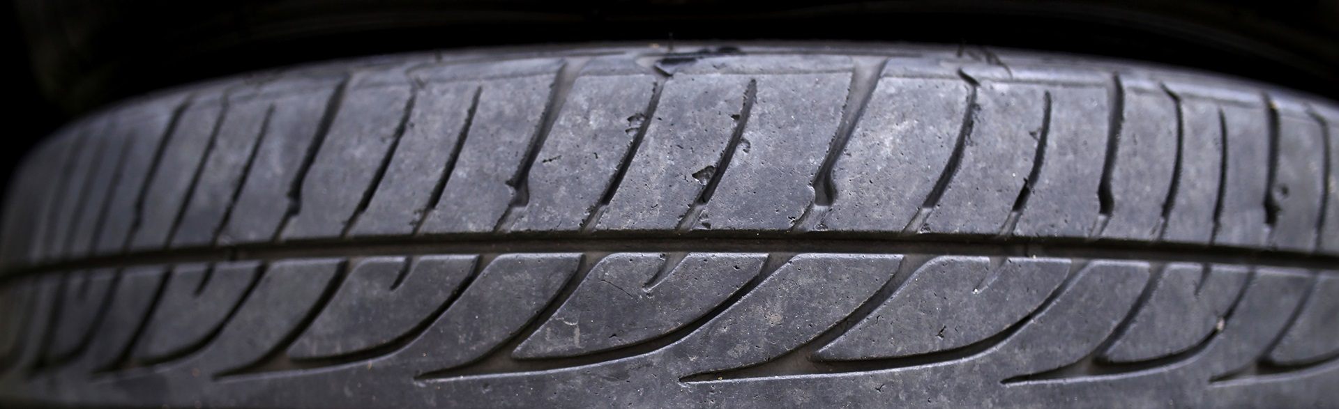A close up of a worn tire tread