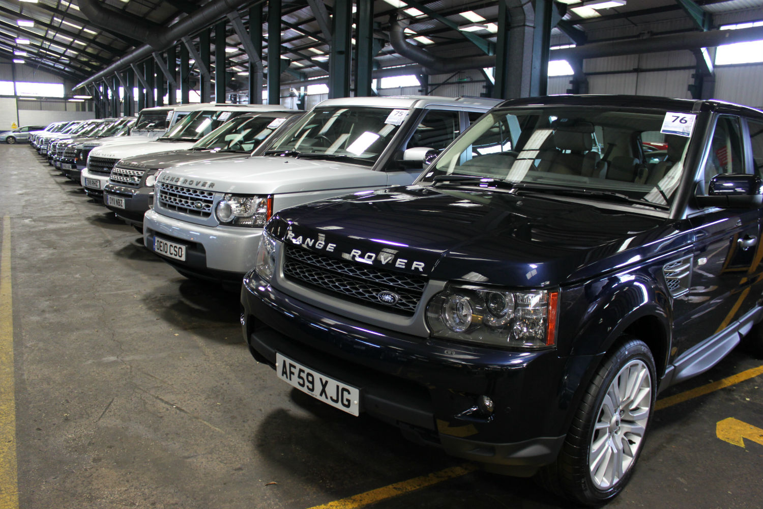 Line up of Land Rovers ready for auction