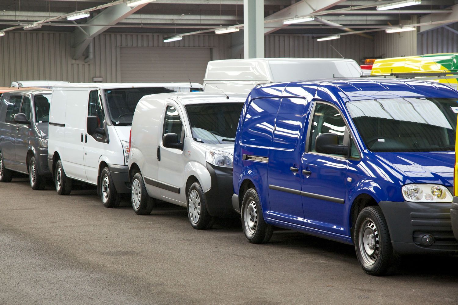 Row of vans to go through auction centre commercial vehicle lots