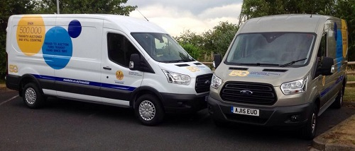 The fully branded and logo'd Manheim Transit 50th vans