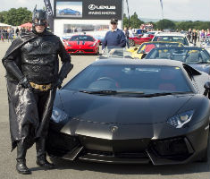 'Batman' with the 'Batmobile' at The Supercar Event for The Children's Trust