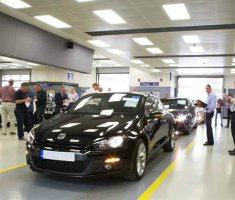 Cars in an auction centre sales queue