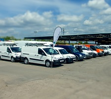 Vans lined up on an auction centre lot