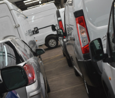 Manheim commercial vehicles lined up at an auction centre