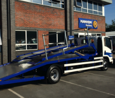 New two car transporter outside Manheim's auction centre in Leeds