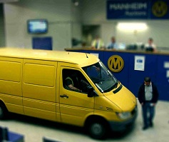 Yellow van at auction centre