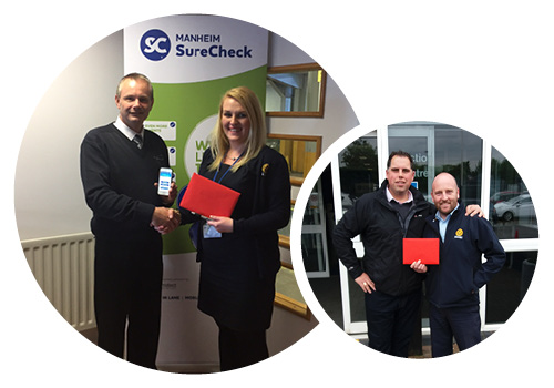 Winners Martin Young and John Agha collecting their vouchers from Manheim