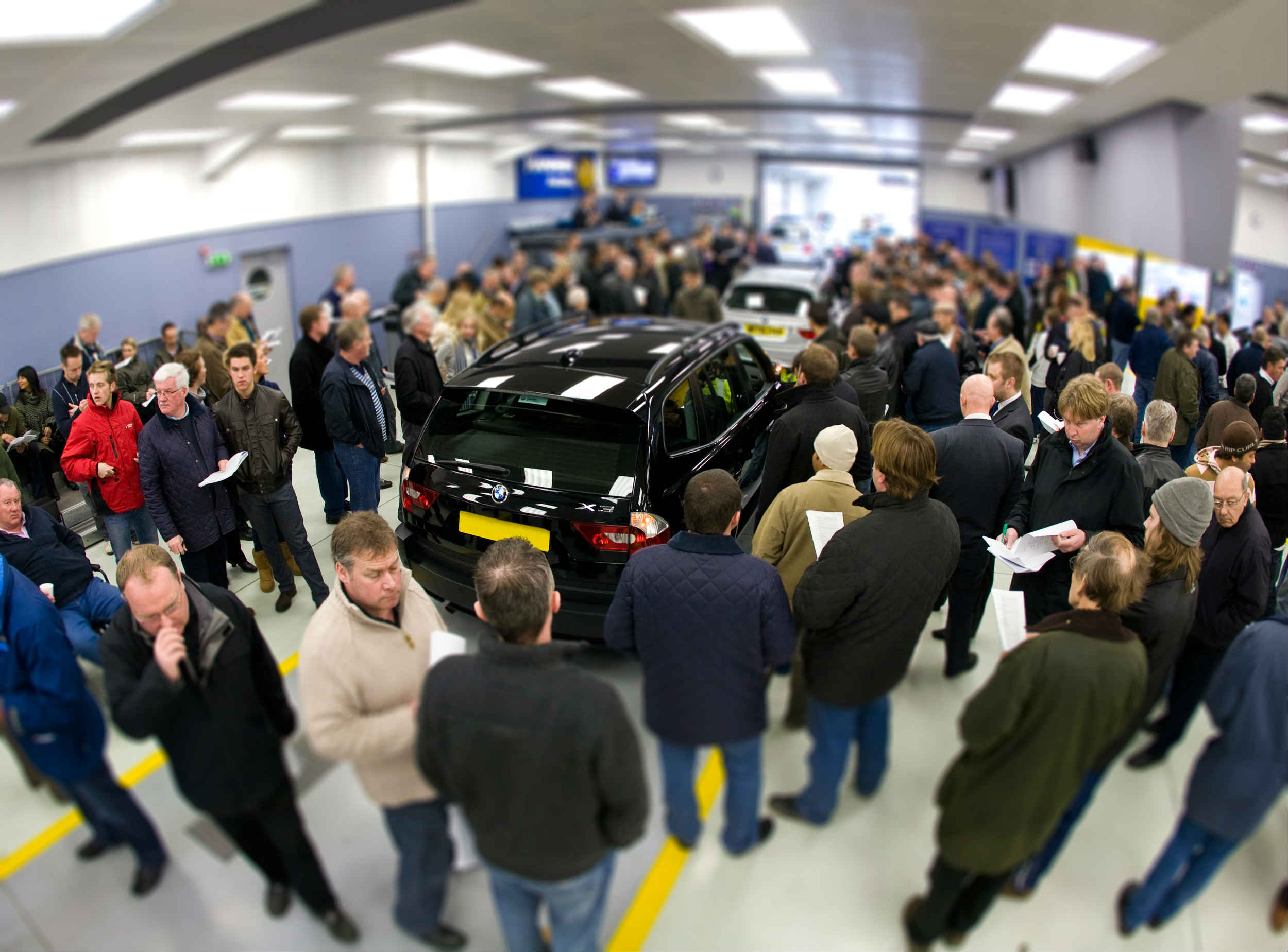 Bidders at a car auction in Colchester
