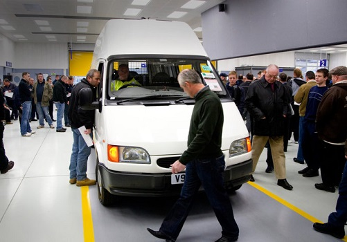 Buyers at a Manheim van auction